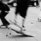 """Sk8ers: Captured in front of San Francisco's Ferry Building in 2013 (I marked it as August 9, 2013 in EXIF).  I had just bought this Olympus OM-1n in flea market in very good condition, so I took it for a spin.  This was a single shot effort.  I felt very good about it, so I didn't take my usual bracket shots for safety.  For that reason, I consider this as my masterpiece.  LOL  But the lack of shutter lag of OM-1n is remarkable (that camera was sold, because I prefer my OM-4T's """"modern"""" convenience, but it's still a fine speciment).  I was sick and tired of jot down exposure notes during that time, so no exposure info, but I believe this to be 1/125"""" or 1/60"""" (just enough to blur this super fast motion and still remain sharp while handheld).  I usually shot at an ISO that's one stop under, so I believe this was shot at ISO 50.  Don't know the aperture, but I am guessing it's f/8.  Olympus OM-1n Ilford Delta 100 low angle handheld shot"""