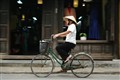 Vietnamese woman on her bike