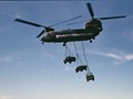 RAF Chinook and Landrovers