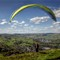 A Leap of Faith: Paraglider about to leap off Bradwell Edge in the Derbyshire Peak District, UK.