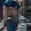 An Overloaded Porter in Syange Village, Nepal