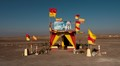 a roadside memorial shrine in the middle of the Atacama desert, north of Chile