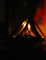 Book in triangle shape under candle light