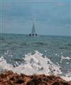 sail boat behind the wave