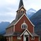 Norwegian Wooden Kirk.: Peaceful wooden country church building  in a valley in Norway.