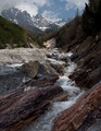 Red rocks and white water in a mountain stream,