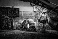 Men laying cobblestones