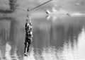 I was in a university class that we were required to use a 35mm camera with black and white film and do all the processing in the dark room this was taken about 2011 my nephew ziplining across a lake in Southern Alberta, Canada