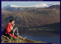 Young hiker on Catbells looking down on Derwent Water with Castlerigg Fell behind