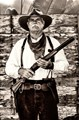 """Train robber and 1880's re-enactor, """"Buffalo Chip"""" seldom smiles.  Including now."""