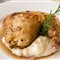 Garlic-Rosemary Roasted Chicken on a Bed of Truffled Mashed Potatoes
