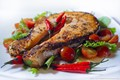Salmon steak with red peppers and tomatoes