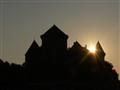 Sun behind Annecy Castle