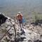 IMG_2302 copyenhanced2: 2/7/09 Nikki climbing Picacho Peak Az....if you fall its a long drop from here....9/12/19 un mask,levels,shadows,cropped..