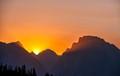 dramatic sunset behind tetons in wyoming