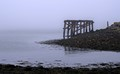 Remains of Jetty in a misty estuary