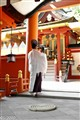 Prepare to pray in a shinto temple