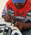 Street mobile phone repairs, Papua New Guinea