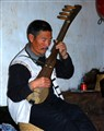 Playing a Chinese stringed instrument