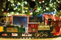 Toy train chugs around the tree and brings excitement to little ones!