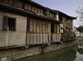 Typical Chinese house adjacent canal