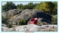 Red chair on rocks in Norway (Straholmen)
