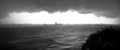 The storm cam in and turned everything black and white.  This was a colour photo but the thick clouds and reflected light from the sea took the colour away