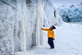 Observing the Ice Wall next to the glacier in Spitsbergen, Svalbard archipelago.