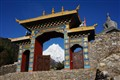 Gate to the Lho Monastery with Manaslu in background