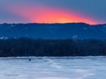 Man on a 4-wheeler admires a late winter sunset, most likely after a day of ice fishing.
