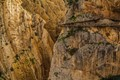 Tiny person walking along the stunning Caminito del Rey in Spain
