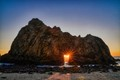 As the sun gets close to the Winter Solstice it is at the right angle to shine through the keyhole at Pfeiffer Beach, Big Sur California.