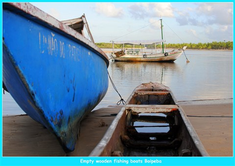 3 wooden fishing boats empty