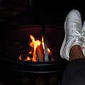 Relaxing by the fire in my sneakers.