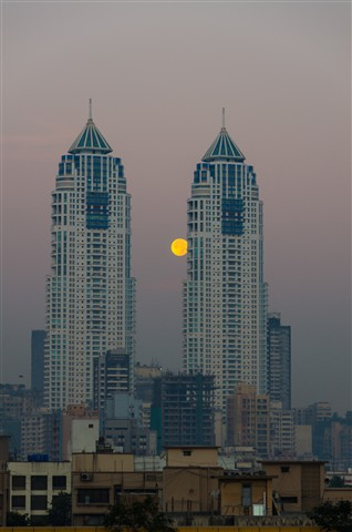 Moon between twin towers of Mumbai India