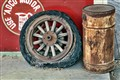 Old Oil Can & a Wheel