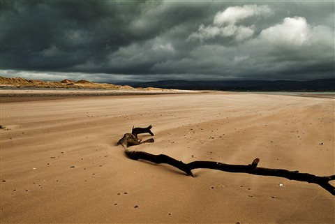 Deserted Beach looking towards Snowdonia