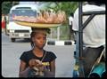 Nigerian Street Vendor sells her goods...