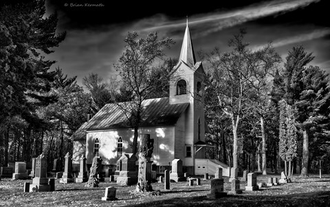 Small rural church with cemetery