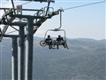 Double transportation: two bikers preparing for a downhill from Mt. Kosciuszko, Australia
