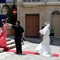 Whose Wedding Is it?: As the photographer gives the orders at St Paul's Shipwreck Church in St Paul's Bay, Malta.