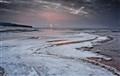 Sunset Over Frozen Beach