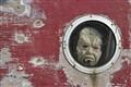 Mask in canal boat window