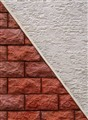 Two Triangles on a House Wall