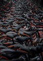 """More than 40,000 """"Mobike"""" sharebikes clog the sidewalks of a Beijing Subway stop."""