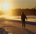 De zon en de schone schaatster