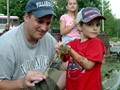 Holding his first frog!