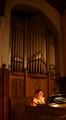 Church organist rehearsing