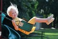 My Granddaughter  Daphne on a swing.