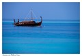 A traditional Maldivian dhow in the beautiful azure ocean